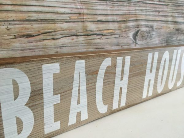 Beach house stained sign
